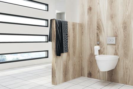 Houten toilet interieur met een handdoek, een betegelde vloer, een witte muur en een oorspronkelijk gevormd raam met uitzicht op de tuin. 3D-weergave mock up