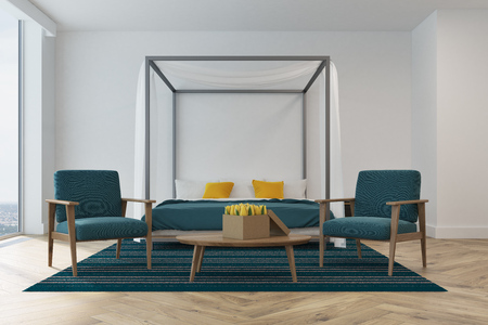 bedroom design: White bedroom interior with a blue master bed, white and yellow pillows, a panoramic window, a carpet and two blue armchairs standing near a coffee table. 3d rendering mock up Stock Photo