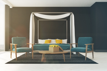 bedroom design: Black bedroom interior with a blue master bed, white and yellow pillows, a panoramic window, a carpet and two blue armchairs standing near a coffee table. 3d rendering mock up toned image