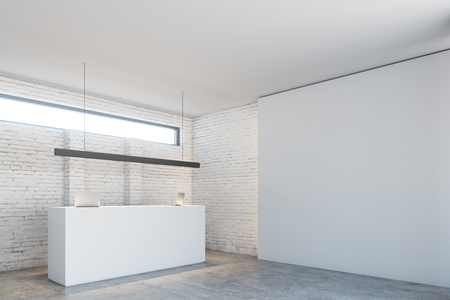White reception table with two laptops is standing in a white brick wall office lobby under a narrow horizontal window. Side view. 3d rendering mock up