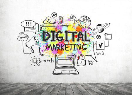 marketing online: Colorful digital marketing sketch drawn on a concrete wall in a room with an old wooden floor. Concept of a start up Stock Photo