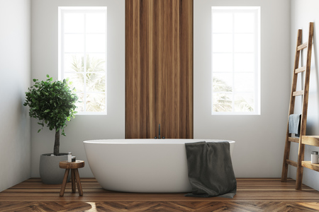 White and wooden bathroom interior with a wooden floor, a white tub, a tree in a pot, two narrow windows and a ladder. 3d rendering mock up Stock Photo