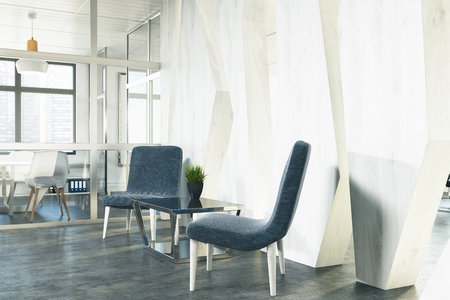 two: Side view of two stylish blue armchairs are standing near a coffee table in an office waiting area. An open space room is in the background. 3d rendering mock up