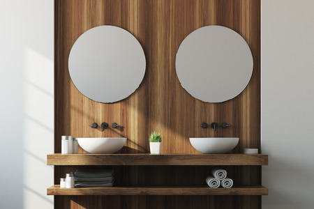 White and wooden bathroom interior with a double sink on a wooden shelf, a potted plant and two round mirrors. 3d rendering