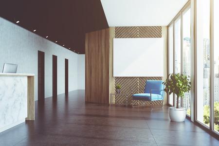Ufficio Bianco E Legno : L angolo di un banco di ricezione bianco e nero è in una lobby di