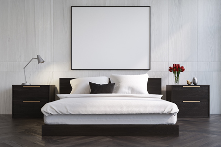 bedspread: White wooden bedroom interior with a dark wooden floor, a master bed with black bedside tables and a large horizontal poster above it. 3d rendering mock up Stock Photo