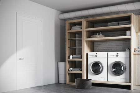 Modern laundry room interior with white brick walls, wooden consoles and shelves with two white washing machines. Corner. 3d rendering