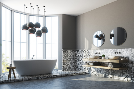 Corner of a white and gray tiles bathroom interior with a large window, a white round tub, a double sink and a black lamp. 3d rendering
