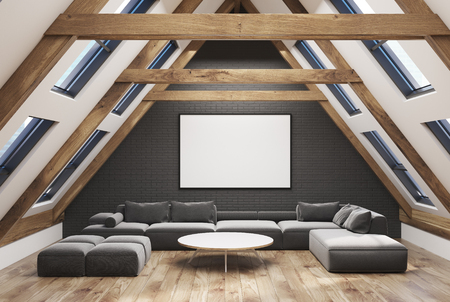 Attic living room interior with a pitched roof, gray walls and a wooden floor. There is a large gray sofa and a narrow round coffee table. 3d rendering mock up