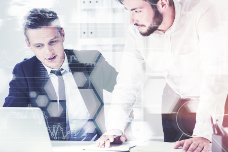 Two young company employees working in a white office. Graphs and infographics. Toned image double exposure Elements of this image furnished by NASA