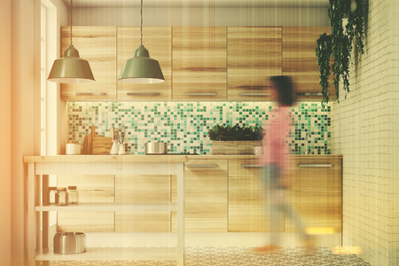 appliance: Woman in an upscale kitchen interior with green and white mosaic walls, large windows, an interesting floor pattern and wooden consoles and a table. 3d rendering toned image double exposure