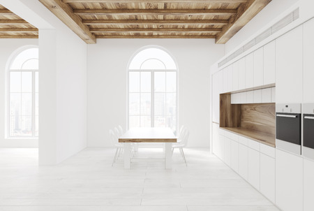 appliance: White kitchen interior with a wooden floor, tall rouded windows, a number of consoles, a long table with chairs near it. 3d rendering mock up
