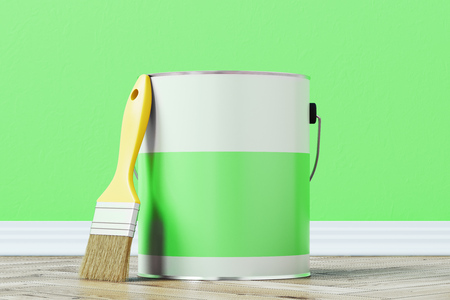 Close up of a green paint bucket standing on a wooden floor against a green wall with a large paintbrush near it. 3d rendering mock up