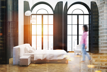 Upscale bedroom interior with tall windows, a wooden floor, white walls and a white bed in the center. Side view, a woman. 3d rendering toned image double exposure