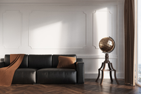 White living room interior with a black leather sofa, a brown blanket and a pillow on it and a stylized globe next to it. 3d rendering mock up