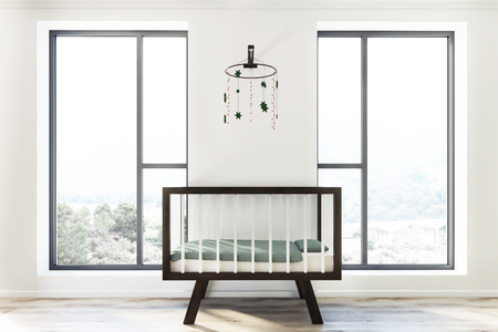 Loft white nursery interior with a wooden crib, a toy hanging above it and two tall windows. 3d rendering