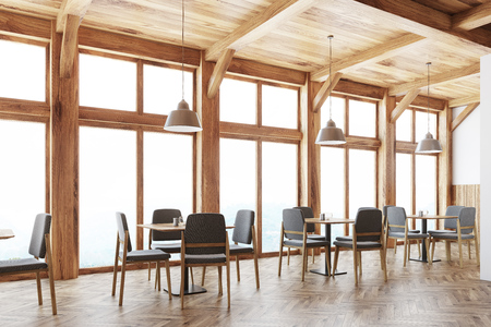 Wooden cafe interior with loft windows, a wooden ceiling and square tables with gray and wooden chairs around them. Side view. 3d rendering Stock Photo