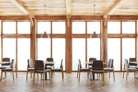 Wooden cafe interior with loft windows, a wooden ceiling and square tables with gray and wooden chairs around them. 3d rendering