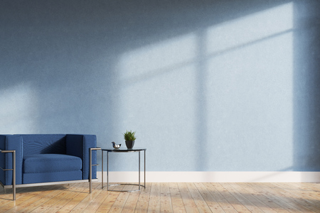 Minimalistic living room interior with blue walls, a wooden floor, a soft blue and silver armchair and a tiny coffee table. 3d rendering mock up Stockfoto