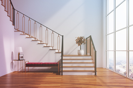 White living room interior with a staircase, a soft red bench, a loft window and a potted tree. 3d rendering mock up toned image