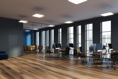 Open space office corner with gray and glass walls, a wooden floor and narrow windows. Rows of computer desks and a conference room. 3d rendering mock up