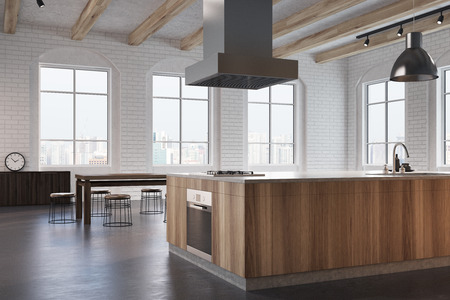 Dining room corner with white brick walls, large windows, a concrete floor, wooden countertops with an oven and a dark wooden table with chairs. A poster. 3d rendering mock up