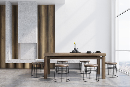 Modern dining room interior with white and wooden walls, a dark wooden table with round chairs near it, a loft window and a fireplace. 3d rendering mock up Stock Photo