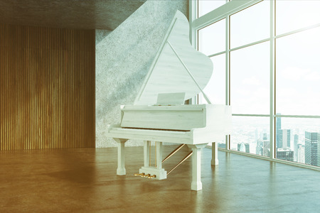White piano in a concrete and wooden room toned Stock Photo