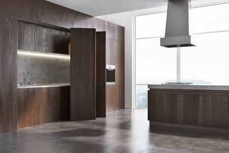 モダンなキッチンのインテリアコーナーには、コンクリートの床と木製の食器棚があり、オーブンと洗面台が組み込まれています。カウンタートッ