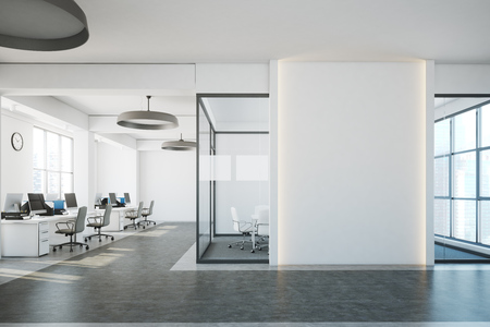 White brick open space office interior with a concrete floor, a blank wall fragment and a row of computer desks along the wall. 3d rendering mock up