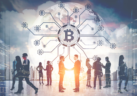 Business people silhouettes against bitcoin network hologram in the sky of a modern city. Double exposure toned image.