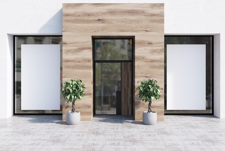 White and wooden cafe exterior with two vertical posters in the windows and two potted trees. 3d rendering mock up Stock Photo