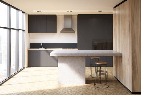 Loft kitchen interior with a wooden floor, white and wooden walls, black countertops, a table and stools. 3d rendering mock up