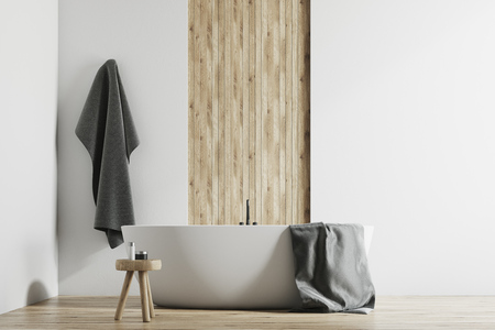 Modern bathroom interior with white and wooden walls, a large bathtub, a small chair and a towel hanging on the wall 3d rendering mock up Stock Photo