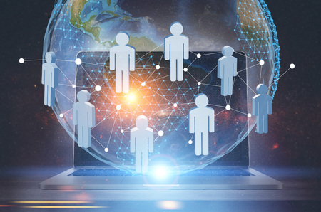 People network hologram in front of a planet model near a laptop. A dark blue background. Concept of new technologies. Toned image double exposure. Elements of this image furnished by NASA