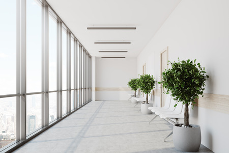 White hospital lobby with a row of doors and white chairs for patients waiting for the doctor visit. 3d rendering mock up Stock Photo
