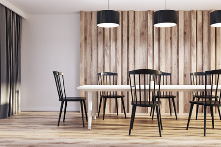 White and wooden dining room interior with a long wooden table, black chairs and an original door. 3d rendering mock up Stock Photo