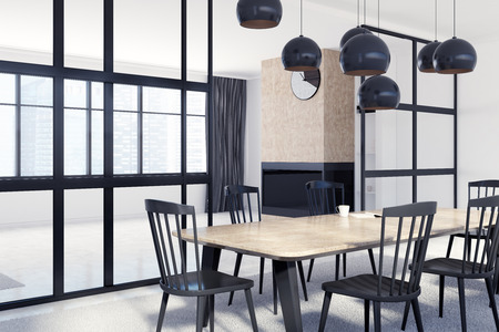 White dining room corner with a long wooden table, black chairs, a fireplace, windows and an original door. 3d rendering