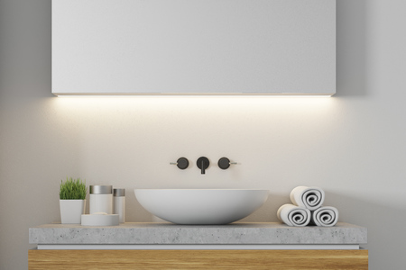 Close up of a white sink standing on a wooden set of drawers in a white bathroom. 3d rendering mock up