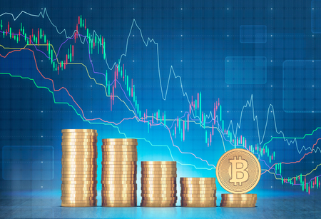 Stacks of bitcoins and green and red graphs against a blurred blue background with infographics. Mock up Stock Photo