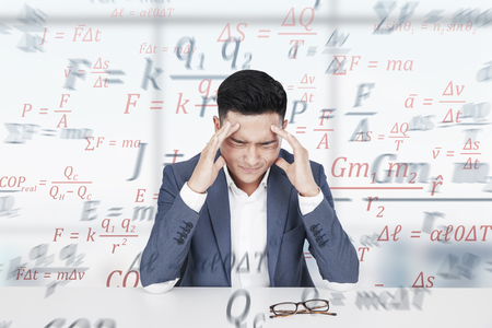 Stressed out Asian man with a strong headache. He is sitting at a table with books. Formulas in the background. 3d rendering mock up double exposure