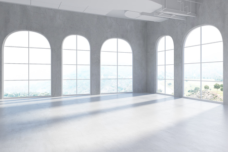 Empty room interior with white walls, a concrete floor and arch like windows. Blurred 3d rendering mock up