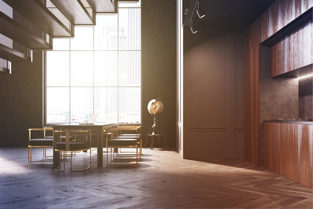 Black kitchen and dining room interior with a dark wooden floor and cupboard, a large window and a long table with soft black chairs. 3d rendering mock up toned image