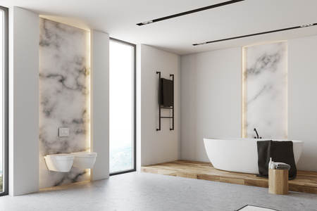 White and marble bathroom corner with a gray floor, a white bathtub, two toilets, and a large window. 3d rendering