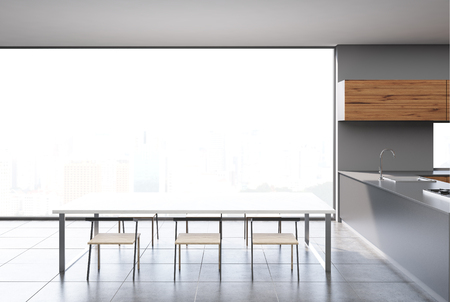 Gray and dark wooden kitchen interior with a concrete floor, a panoramic window, and a long wooden table with chairs. 3d rendering mock up