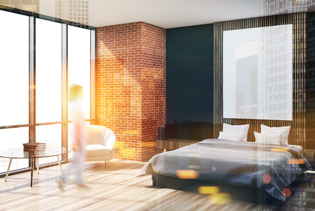 Modern bedroom corner with black, brick and wooden walls, a concrete floor, an armchair and a master bed with a poster hanging above it. Blurred 3d rendering mock up double exposure toned image Banque d'images - 91706147