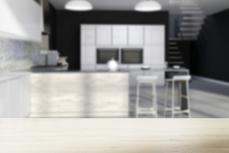 Black kitchen interior with a mosaic wall, a concrete floor, white cupboards and a bar with stools. Blurred 3d rendering mock up Stock Photo