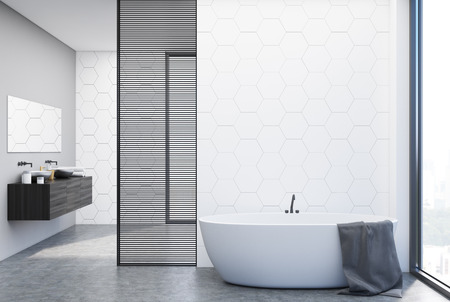 White hexagon tile bathroom interior with a double sink standing on a black shelf and a white bathtub. 3d rendering mock up
