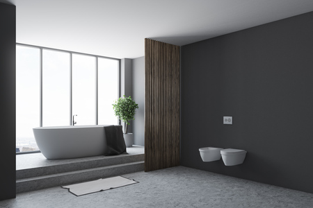 Black bathroom corner with a concrete floor, a white tub, and two toilets. A panoramic window. 3d rendering mock up