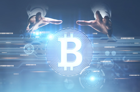 Unrecognizable businessman s hands above a round bitcoin hologram. A blurred blue background. Toned image double exposure mock up. Stock fotó - 92656620